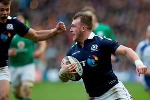 Scotland's Stuart Hogg runs for the line to score his side's second try during the RBS 6 Nations match at BT Murrayfield Stadium, Edinburgh. PA