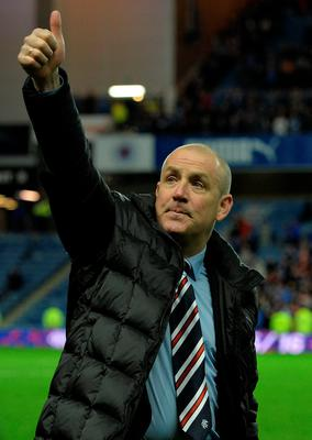 Rangers manager Mark Warburton celebrates on the pitch as Rangers beat Dumbarton 1-0 to clinch the Scottish Championship