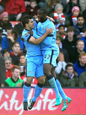 Manchester City's Yaya Toure celebrates scoring his sides first goal of the game with his team-mate Sergio Aguero (left) during the Barclays Premier League match at St Mary's Stadium, Southampton. Nick Potts/PA Wire.