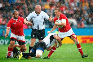 LEICESTER, ENGLAND - OCTOBER 06:  Nick Blevins of Canada is tackled by Valentin Poparlan of Romania during the 2015 Rugby World Cup Pool D match between Canada and Romania at Leicester City Stadium on October 6, 2015 in Leicester, United Kingdom.  (Photo by Laurence Griffiths/Getty Images)