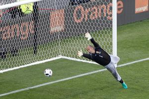 Hungary goalkeeper Gabor Kiraly fails to stop a shot from Portugal's Cristiano Ronaldo during the Euro 2016 Group F soccer match between Hungary and Portugal at the Grand Stade in Decines-Charpieu, near Lyon, France, Wednesday, June 22, 2016. (AP Photo/Michael Sohn)