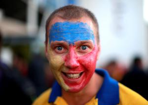 A Romanian supporter shows their support ahead of the World Cup match at Leicester City Stadium, Leicester. PRESS ASSOCIATION Photo. Picture date: Tuesday October 6, 2015. See PA story RUGBYU Canada. Photo credit should read: David Davies/PA Wire. RESTRICTIONS: Editorial use only. Strictly no commercial use or association without RWCL permission. Still image use only. Use implies acceptance of Section 6 of RWC 2015 T&Cs at: http://bit.ly/1MPElTL Call +44 (0)1158 447447 for further info.