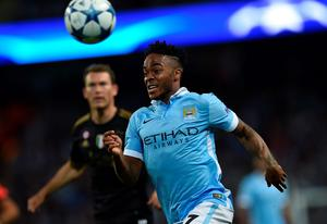 Manchester City's English midfielder Raheem Sterling runs for the ball during a UEFA Champions League group stage football match between Manchester City and Juventus at the Etihad stadium in Manchester, north-west England on September 15, 2015.  AFP PHOTO / PAUL ELLISPAUL ELLIS/AFP/Getty Images