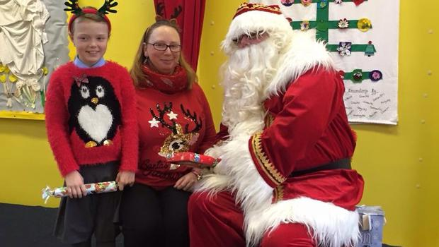 Patricia Forsythe and daughter Kiera pictured in their festive jumpers with Santa.