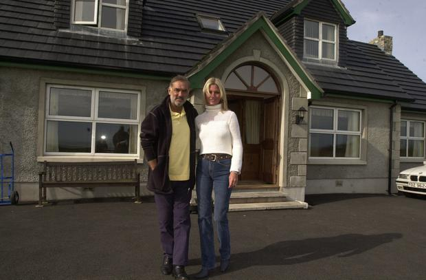 George Best and wife Alex outside their seaside home on the Ards Peninsula, Portavogie. 5/10/2000