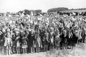 The Queen. NI visit 1953.  Ballycarry children celebrate the Queen's Coronation.