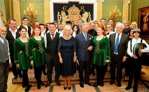 The Prince of Wales and the Duchess of Cornwall pose with performers during a reception and concert featuring performers from Northern Ireland at Hillsborough Castle, in Belfast, Northern Ireland.