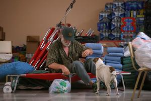 CLEARLAKE OAKES, CA - AUGUST 04:  An evacuated resident wakes up at the Moose Lodge where several dozen Rocky Fire evacuees are staying on August 4, 2015 in Clearlake Oakes, California. Nearly 3,000 firefighters are battling the Rocky Fire that has burned 65,000 acres and has forced the evacuation of 12,000 residents in Lake County. The fire is currently 12 percent contained and has destroyed at least 14 homes. 6,300 homes are threatened by the fast moving blaze.  (Photo by Justin Sullivan/Getty Images)