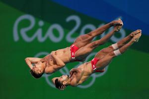 RIO DE JANEIRO, BRAZIL - AUGUST 08:  Ivan Garcia and German Sanchez of Mexico compete in the Men's Diving Synchronised 10m Platform Final on Day 3 of the Rio 2016 Olympic Games at Maria Lenk Aquatics Centre on August 8, 2016 in Rio de Janeiro, Brazil.  (Photo by Laurence Griffiths/Getty Images)