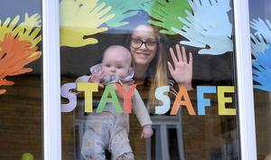Scarborough residents place messages in their windows Neavie and Ella Bulman look out of their window. pic Richard Ponter