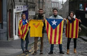 EDINBURGH, SCOTLAND - SEPTEMBER 18:  Sara Tardio, Marc Arranz, Marc Teixidor and Clara de Pablo from Catalonia pose for a photograph as they show their support for the Yes vote in central Edinburgh on September 18, 2014 in Edinburgh, Scotland. After many months of campaigning the people of Scotland today head to the polls to decide the fate of their country. The referendum is too close to call but a Yes vote would see the break-up of the United Kingdom and Scotland would stand as an independent country for the first time since the formation of the Union.  (Photo by Matt Cardy/Getty Images)