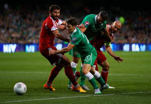 DUBLIN, IRELAND - SEPTEMBER 07:  (L-R) Ucha Lobjanidze of Georgia, Wes Hoolahan of the Republic of Ireland, Jonathan Walters of the Republic of Ireland and Jaba Kankava of Georgia battle for the ball during the UEFA EURO 2016 Group D qualifying match between Republic of Ireland and Georgia at Aviva Stadium on September 7, 2015 in Dublin, Ireland.  (Photo by Ian Walton/Getty Images)
