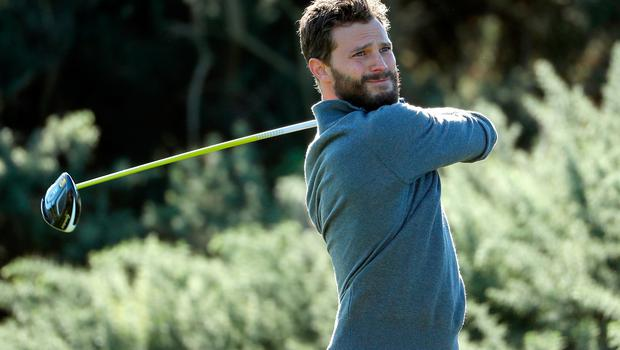 KINGSBARNS, AL - OCTOBER 05:  Actor Jamie Dornan plays during a practice round at the Alfred Dunhill Links Championship at Kingsbarns Golf Links golf course on October 5, 2016 in St Andrews, Scotland.  (Photo by Richard Heathcote/Getty Images)