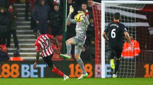 Liverpool's goalkeeper Simon Mignolet saves a shot from Southampton's Eljero Elia during the Barclays Premier League match at St Mary's, Southampton. Chris Ison/PA Wire.