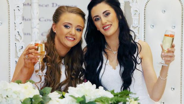 Robyn Peoples and Sharni Edwards become the first same-sex couple to marry in Northern Ireland following their marriage ceremony at the Loughshore Hotel in Carrickfergus, Co. Antrim. Picture by Jonathan Porter/PressEye