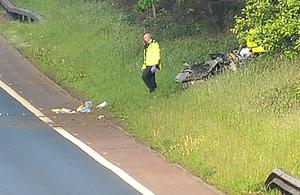 Alan Lewis - PhotopressBelfast.co.uk    7-6-2015 Police at the scene of a serious road traffic accident tonight on the M2 onslip at the Drumsilly roundabout near Antrim.  The motorway has been closed and long tailbacks are causing traffic chaos in the area.  One vehicle appears to be on its roof in trees at the side of the fast lane around one hundred metres beyond the point where the onslip joins the motorway.