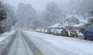 Heavy snow has caused widespread travel disruption in Northern Ireland, with bus and rail services affected and some roads closed.