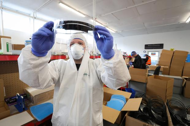 Employees from Denroy Group assemble quantities of the Hero Shield visor at the factory in Bangor, County Down