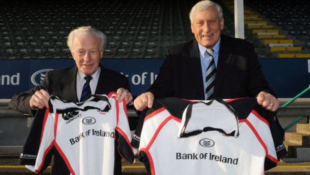 Rugby legends Jack Kyle and Willie John McBride holding up their Ulster Rugby Jerseys ahead of the Ulster match against the Dragons at Ravenhill.