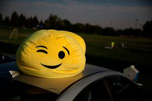 "CASPER, WY - AUGUST 21:  An emoji stuffed toy sits on the roof of a car at South Mike Sedar Park on August 21, 2017 in Casper, Wyoming. Millions of people have flocked to areas of the U.S. that are in the ""path of totality"" in order to experience a total solar eclipse. During the event, the moon will pass in between the sun and the Earth, appearing to block the sun.  (Photo by Justin Sullivan/Getty Images)"