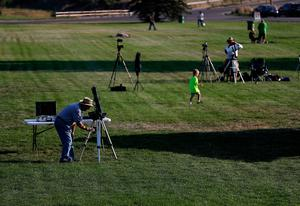 "CASPER, WY - AUGUST 21:  People set up cameras and telescopes as they prepare to watch the total eclipse at South Mike Sedar Park on August 21, 2017 in Casper, Wyoming. Millions of people have flocked to areas of the U.S. that are in the ""path of totality"" in order to experience a total solar eclipse. During the event, the moon will pass in between the sun and the Earth, appearing to block the sun.  (Photo by Justin Sullivan/Getty Images)"