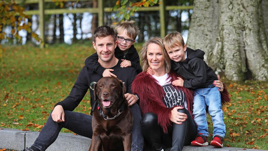 Jonathan Rea and wife Tatia back at their home in County Antrim with sons, Jake and Tyler, along with their dog Bruno.  Photo by Peter Morrison