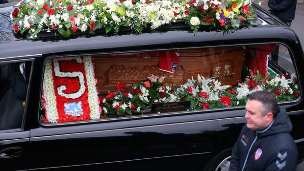 The funeral cortege of Derry City football captain Ryan McBride arrives at the Long Tower church in Londonderry, he was found dead at home on Sunday night aged 27. Niall Carson/PA Wire