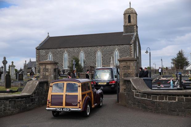 PACEMAKER,BELFAST,7/5/2020: As the funeral cortege of John Dallat arrives at St Mary's church outside Kilrea in Co. Derry it is followed by the former SDLP MLA's favourite car, a Morris Minor Traveller. PICTURE BY STEPHEN DAVISON