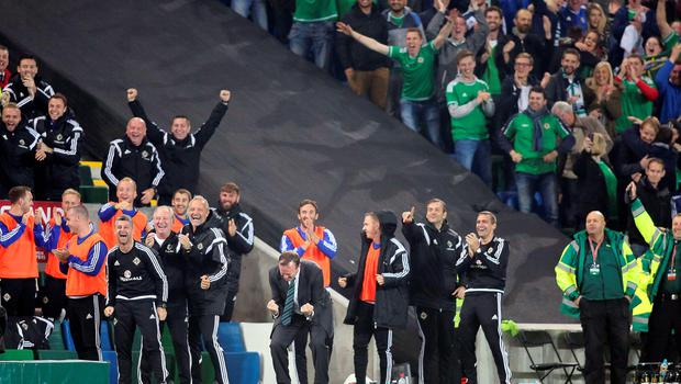 Northern Ireland's manager Micheal O'Neill (C)c celebrates his team's second goal  during the UEFA Euro 2016 qualifying Group F football match between Northern Ireland and Greece at Windsor Park in Belfast, Northern Ireland, on October 8, 2015.    AFP PHOTO / PAUL FAITHPAUL FAITH/AFP/Getty Images
