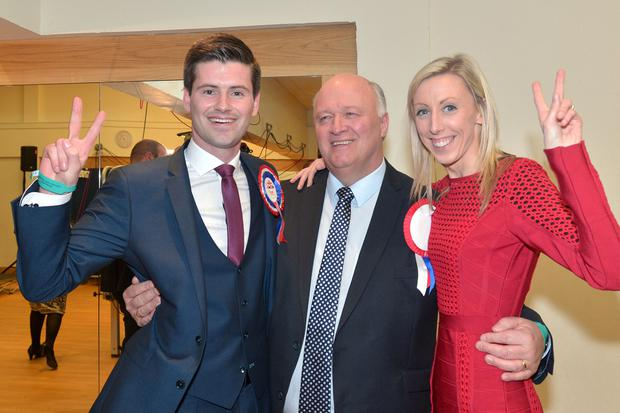 Press Eye - Belfast - Northern Ireland - 3 March 2017 - NI Assembly Election 2017 Count at Banbridge Leisure Centre for Newry & Armagh and Upper Bann constituencies. The Dup's Jonathan Buckley, left, celebrates being elected with fellow MLA, Carla Lockhart and Upper Bann MP, David Simpson. Photo by Tony Hendron / Press Eye.