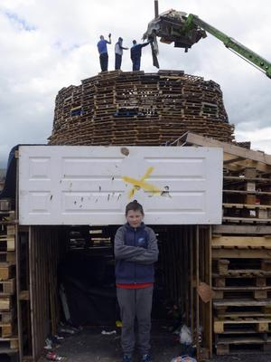 Preparations get underway at the Bonfire in Lanark Way in Belfast,  ahead of the 12th of July annual Orange celebrations Pic Pacemaker