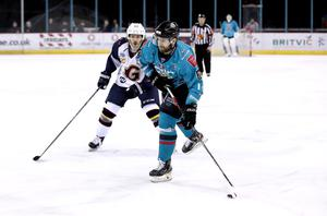 Belfast Giants' Lewis Hook with Guildford Flames' Erik Lindhagen during Saturday night's Elite League game at the SSE Arena (William Cherry/Presseye)