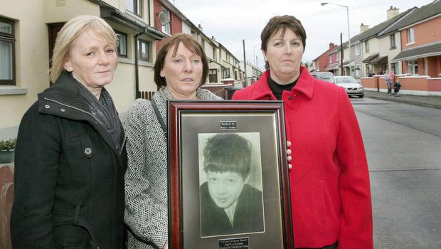 Daniel Hegarty's sisters Philomena, Kathleen and Margaret at the spot where he was shot by a British soldier  in the Creggan Estate Derry on July 31,  1972. [Photo: Margaret McLaughlin 05-12-11]