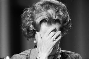 FILE - APRIL 8: Lord Bell, spokesperson for Baroness Margaret Thatcher, announced in a statement that the former British Prime Minister died peacefully following a stroke aged 87.   British prime minister Margaret Thatcher covering her face with her hand at the 1985 Conservative Party Conference.   (Photo by Keystone/Getty Images)
