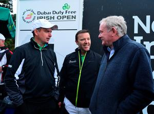 NEWCASTLE, NORTHERN IRELAND - MAY 27 : Deputy First Minister Martin McGuinness (R), talking with Peter Lawrie of Ireland on the 1st tee during the afternoon Pro-Am during the Irish Open Previews at Royal County Down Golf Club on May 27, 2015 in Newcastle, United Kingdom. (Photo by Mark Runnacles/Getty Images)