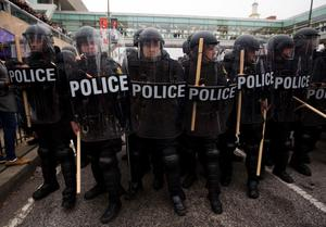 Riot police hold their position during a protest in Baltimore, Maryland, on April 25, 2015, against the death of Freddie Gray while in police custody. Protesters targeted businesses and smashed police cars in downtown Baltimore on Saturday as the biggest demonstration yet over the death of Gray in police custody turned violent.  AFP PHOTO / ANDREW CABALLERO-REYNOLDSAndrew Caballero-Reynolds/AFP/Getty Images