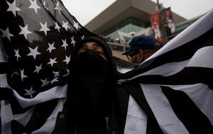 A protester shouts during a rally in Baltimore, Maryland, on April 25, 2015, against the death of Freddie Gray while in police custody. Protesters targeted businesses and smashed police cars in downtown Baltimore on Saturday as the biggest demonstration yet over the death of Gray in police custody turned violent.  AFP PHOTO / ANDREW CABALLERO-REYNOLDSAndrew Caballero-Reynolds/AFP/Getty Images