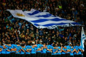 MILTON KEYNES, ENGLAND - OCTOBER 06:  Uruguay players line up in front of their fans prior to the 2015 Rugby World Cup Pool A match between Fiji and Uruguay at Stadium mk on October 6, 2015 in Milton Keynes, United Kingdom.  (Photo by Paul Gilham/Getty Images)