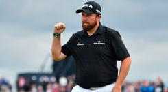 Shane Lowry celebrates a putt on the 15th hole during the third round of The Open Championship at Royal Portrush (Glyn Kirk/AFP)