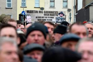 Mourners hold a banner for the late Martin McGuinness as they make their way to the funeral on March 23, 2017 in Londonderry, Northern Ireland. The funeral is held for Northern Ireland's former Deputy First Minister Martin McGuinness who died on Monday 20th March 2017. He was once chief of staff of the IRA but later became Sinn Fein's chief negotiator in the talks that led to the Good Friday agreement bringing peace to Northern Ireland.  (Photo by Charles McQuillan/Getty Images)