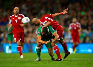 DUBLIN, IRELAND - SEPTEMBER 07:  Zurab Khizanishvili of Georgia challenges Jonathan Walters of the Republic of Ireland during the UEFA EURO 2016 Group D qualifying match between Republic of Ireland and Georgia at Aviva Stadium on September 7, 2015 in Dublin, Ireland.  (Photo by Ian Walton/Getty Images)