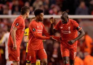 Liverpool's French defender Mamadou Sakho (R) celebrates with Liverpool's English striker Daniel Sturridge (C) after scoring during the UEFA Europa league quarter-final second leg football match between Liverpool  and Borussia Dortmund at Anfield stadium in Liverpool on April 14, 2016. / AFP PHOTO / OLI SCARFFOLI SCARFF/AFP/Getty Images