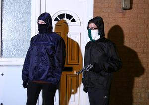 Mock gunmen re-run the route taken by the shooters as they revisit the scene of the Joe Reilly murder appealing to the public for information on October 27th 2016, Northern Ireland (Photo by Kevin Scott / Presseye)