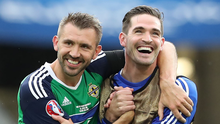 Northern Ireland's Gareth McAuley and Kyle Lafferty celebrate at the final whistle after defeating Ukraine during Thursdays second Euro 2016 game at the Stade de Lyon, France.