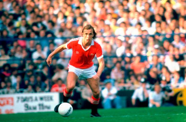 Pulling strings: Sammy McIlroy in action for Man United