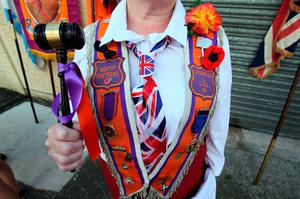An Orangewoman is pictured taking part in the annual July 12 parade in Belfast, on July 12, 2017. July 12 is the main marching day in the Orange Order calendar. The parades mark the Protestant commemoration of the 327th anniversary of King William III's victory at the Battle of the Boyne in 1690. / AFP PHOTO / Paul FAITHPAUL FAITH/AFP/Getty Images