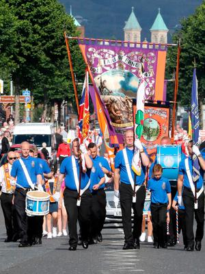 Bands take part in the annual July 12 parade in Belfast, on July 12, 2017. July 12 is the main marching day in the Orange Order calendar. The parades mark the Protestant commemoration of the 327th anniversary of King William III's victory at the Battle of the Boyne in 1690. / AFP PHOTO / Paul FAITHPAUL FAITH/AFP/Getty Images