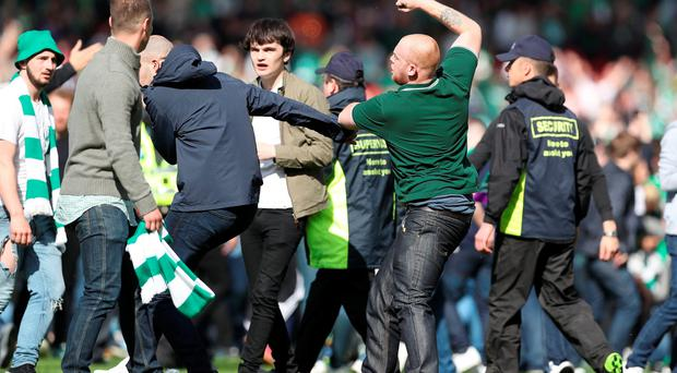 GLASGOW, SCOTLAND - MAY 21: Hibs and Rangers fans fight as they invade the pitch during the Scottish Cup Final between Rangers and Hibernian at Hampden Park on May 21, 2016 in Glasgow, Scotland. (Photo by Ian MacNicol/Getty)