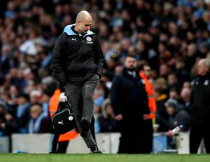 Manager Pep Guardiola kicked a bottle after Fernandinho scored an own-goal to give Crystal Palace a draw (Martin Rickett/PA)
