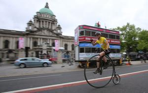 Cyclist Joff Summerfield, who circumnavigated the globe on a penny farthing, finishes his most grueling challenge yet at Belfast City Hall as he sets the pro riders a time to beat when he rides the Giro d'Italia time trial route on his penny farthing. PRESS ASSOCIATION Photo. Picture date: Thursday May 8, 2014. Photo credit should read: Niall Carson/PA Wire